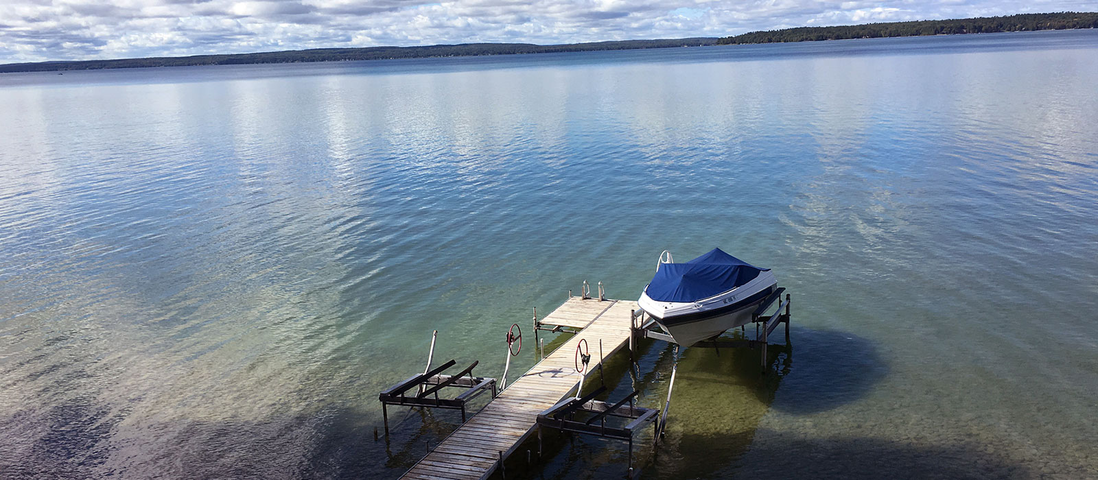 Northern lakes property management one cottage rentals in for Mullett lake fishing